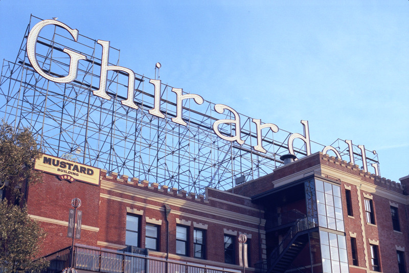 The huge sign, composed of more lightbulbs than you can count, stretches the full length of the Mustard and Cocoa Buildings in Ghirardelli Square. The camera was pointed up from the main plaza of Ghirardelli, near the Chocolate Shop.